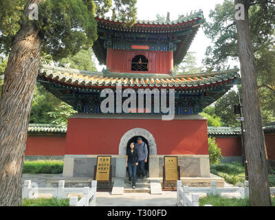 BEIJING, CHINA- OCTOBER 4, 2015: tourists inspect a bell tower inside beihai park in beijing, China - Stock Photo