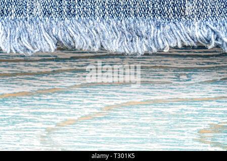 Denim texture on blue wooden background, border - Stock Photo