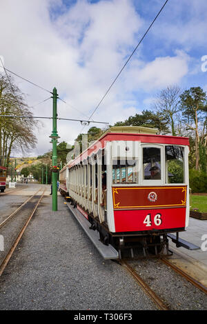 Heritage Manx Electric Railway train set of two carriages at Laxey station before carrying on to Ramsey with one closed and one open car - Stock Photo