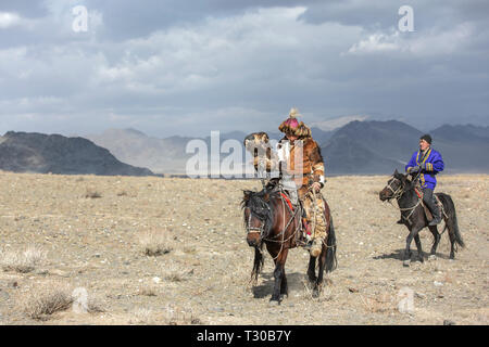 bayan Ulgii, Mongolia, 4th October 2015: kazakh eagle hunter in alandscape of western Mongolia - Stock Photo