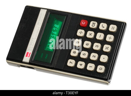 1970's pocket calculator. Simple arithmetic machine, handheld device. Sharp ELSI MATE EL-8031 - Stock Photo