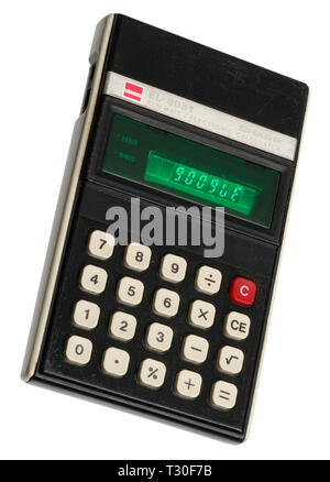 1970's pocket calculator. Simple arithmetic machine, handheld device. Sharp ELSI MATE EL-8031. The word Google spelt out on the display. - Stock Photo