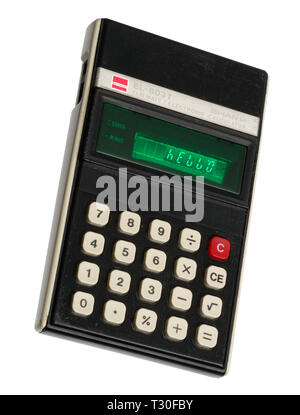 1970's pocket calculator. Simple arithmetic machine, handheld device. Sharp ELSI MATE EL-8031. The word HELLO spelt out on the display. - Stock Photo