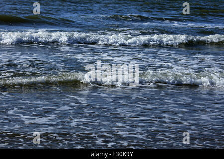 Sea shore with beautiful slow waves. Blue wave in ocean. Swell for surfing in sea. - Stock Photo