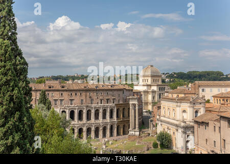 Panoramic view of city Rome with Roman forum and Theatre of Marcellus (Teatro Marcello) is an ancient open-air theatre in Rome - Stock Photo