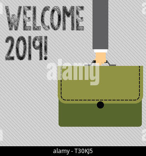 Text sign showing Welcome 2019. Business photo showcasing instance or analysisners of greeting someone like new year Businessman Hand Carrying Colorfu - Stock Photo