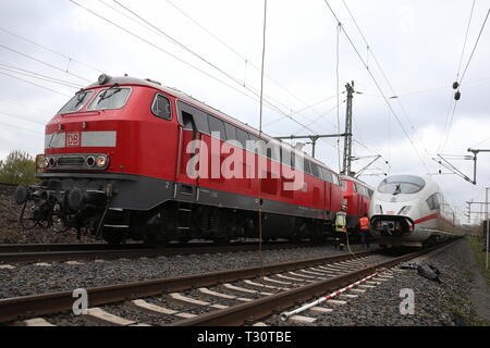 05 April 2019, North Rhine-Westphalia, Düsseldorf: An ICE (r) of the Deutsche Bahn is located near the main station after the overhead line has been torn down. The replacement train is parked next to the defective train. Photo: David Young/dpa - Stock Photo
