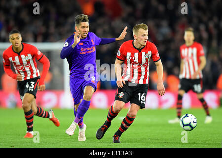 Southampton, UK. 5th April, 2019. Southampton midfielder James Ward-Prowse shields the ball from Liverpool forward Roberto Firmino during the Premier League match between Southampton and Liverpool at St Mary's Stadium, Southampton  Editorial use only, license required for commercial use. No use in betting, games or a single club/league/player publications. Photograph may only be used for newspaper and/or magazine editorial purposes. Credit: MI News & Sport /Alamy Live News - Stock Photo
