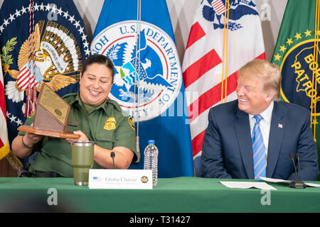 President Donald J. Trump participates in a roundtable to discuss immigration and border security with government officials, law enforcement officers, and border agents, including Gloria Chavez, the Chief Patrol Agent, El Centro Sector for U.S. Customs and Border Protection, Friday, April 5, 2019, in Calexico, Calif  People:  President Donald Trump - Stock Photo