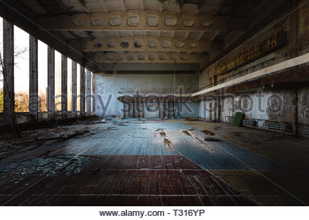 Abandoned sport room in Pripyat city, Chernobyl Exlusion Zone 2019 angle shot - Stock Photo