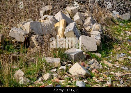Builder's rubble illegally dumped in the countryside - Stock Photo