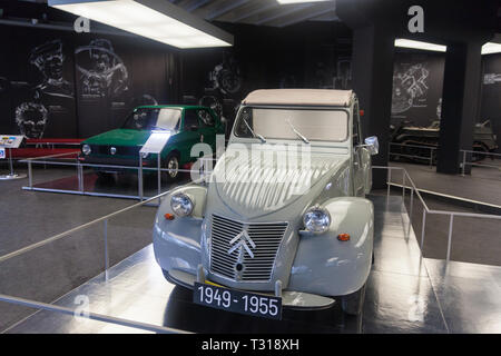 Winkl, Austria - 27 July 2018: An old Citroen car in front and an old Golf Volkswagen car in the back in a museum Success story of the automobile - Stock Photo