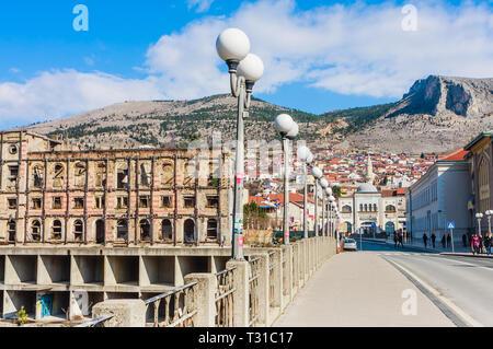 The ruins of the Hotel Neretva, nicknamed 'Tito's palace', at Mostar, Bosnia and Herzegovina - Stock Photo
