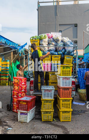 February 2019. Phuket Town Thailand. Workers at the 24 hour local fruit market in old Phuket Town - Stock Photo
