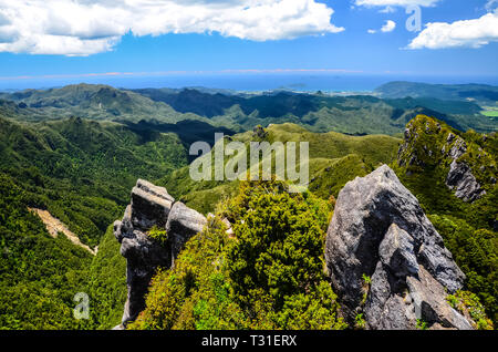 View from the top of The Pinnacles Track Hike with blue sky above at Coromandel Peninsula, North Island, New Zealand. - Stock Photo