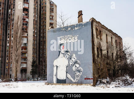 Many buildings in Sarajevo still show the damage scars of the 1992-96 siege of the city - Stock Photo