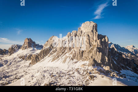 Scenic view of Ra Gusela peak in front of mount Averau and Nuvolau, in Passo Giau, high alpine pass near Cortina d'Ampezzo, Dolomites, Italy - Stock Photo