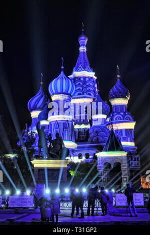 = St. Basil's Cathedral Painted by Light in Blue Color with White Stripes =  View from Red Square on St. Basil's Cathedral painted by light in blue co - Stock Photo