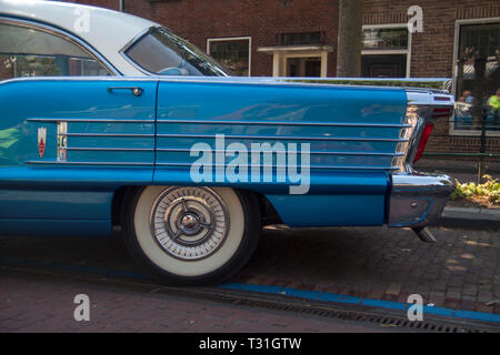 MEDEMBLIK, THE NETHERLANDS - JULY 27,2014:  Side view of a Oldsmobile eighty eight car 1958 on a oldtimer show - Stock Photo