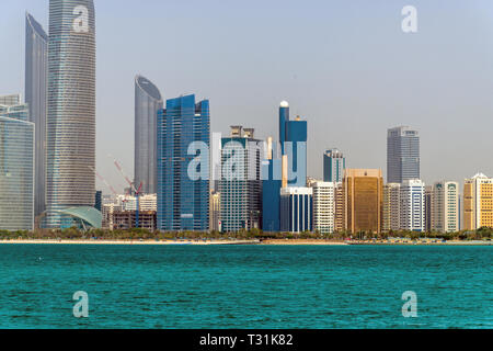 Abu Dhabi, UAE - April 5. 2019. The high-rise buildings on Corniche Road - Stock Photo