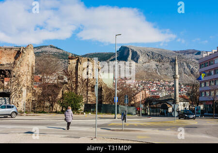 Abandoned building, detroyed during Bosnian War at Bulevar Street in Mostar city, Bosnia and Herzegovina - Stock Photo