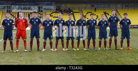 LIVINGSTON, SCOTLAND - 5th MARCH 2014: Scotland National Men's U19s lineup that includes, Jason Cummings, Liam Henderson and Scott McKenna. - Stock Photo
