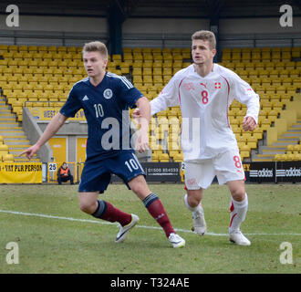 LIVINGSTON, SCOTLAND - 5th MARCH 2014: Scotlands Mens U19s footballer, Jason Cummings waiting for the ball during a European cup match. - Stock Photo