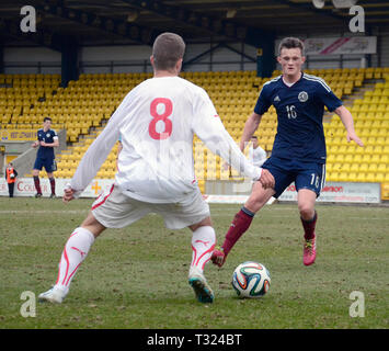 LIVINGSTON, SCOTLAND - 5th MARCH 2014: Scotlands Mens U19s footballer, Liam Henderson eyeing up the ball during a European cup match. - Stock Photo