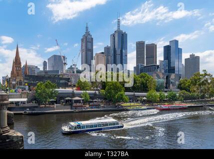 Melbourne River cruise boat on the Yarra River in front of the Central Business District (CBD), Princes Bridge, Melbourne, Victoria, Australia - Stock Photo