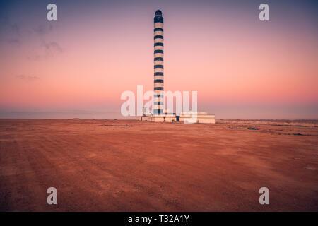 Lighthouse in Dakhla at sunset. Dakhla, Western Sahara, Morocco. - Stock Photo