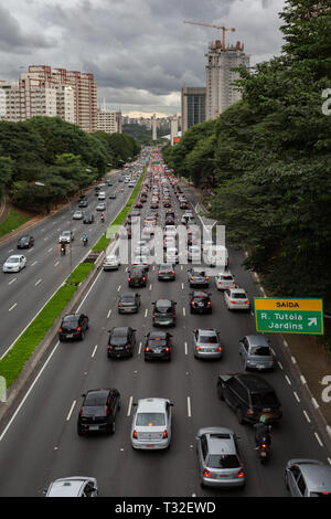 View of an avenue (Av. Vinte e Tres de Maio) were bursting with vehicles in one direction. Heavy traffic plagues Sao Paulo downtown, Brazil - Stock Photo