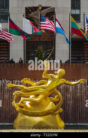 Statue of Prometheus in the lower plaza of the Rockefeller Center, Manhattan, New York, New York State, United States of America.  The gilded bronze s - Stock Photo
