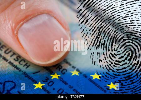 PHOTOMONTAGE, thumb on German identity card with EU flag and fingerprint, FOTOMONTAGE, Daumen auf deutschem Personalausweis mit EU-Fahne und Fingerabd - Stock Photo