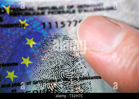 PHOTOMONTAGE, finger on German identity card with EU flag and fingerprint, FOTOMONTAGE, Finger auf deutschem Personalausweis mit EU-Fahne und Fingerab - Stock Photo