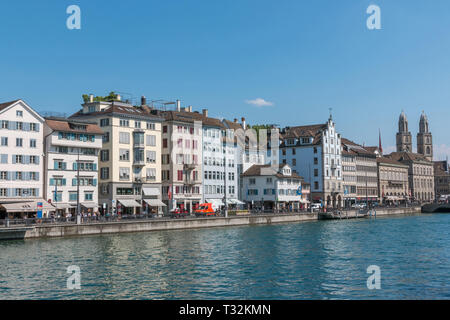 Zurich, Switzerland - June 19, 2017: Panoramic view of historic Zurich city center with famous Grossmunster Church and river Limmat. Summer day with b - Stock Photo