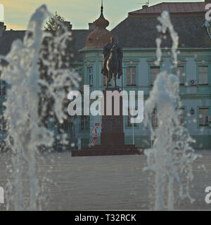 ZRENJANIN, SERBIA, OCTOBER 14th 2018 - Monument of King Peter between fountain water jets - Stock Photo