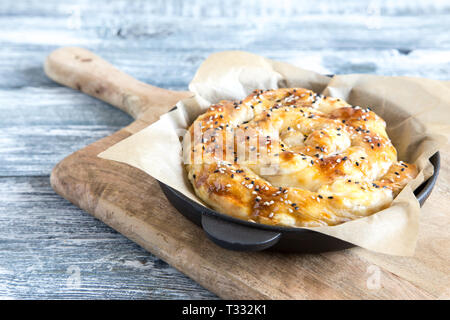 Vertuta, traditional Romanian, Moldavian or Balkan baking pie. Spiral filo pastry pie. - Stock Photo