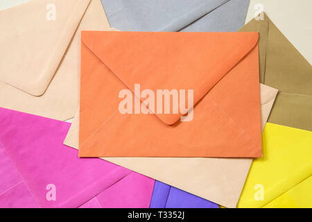 Pile of the colorful envelopes - Stock Photo