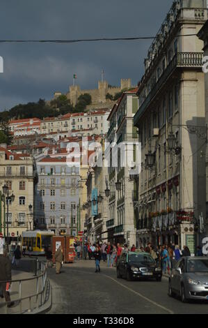 Figueira Square With Views Of The Castle Of San Jorge In Lisbon. Nature, Architecture, History, Street Photography. April 11, 2014. Lisbon, Portugal. - Stock Photo