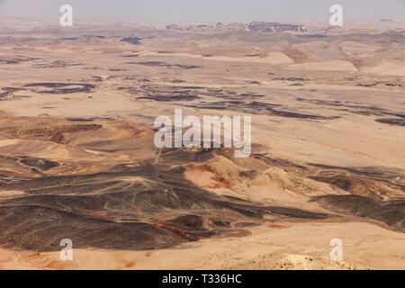 desert landscape of the Ramon Crater (Makhtesh Ramon), the largest in the world, in the Nature reserve, Mitzpe Ramon, Negev desert, Israel - Stock Photo