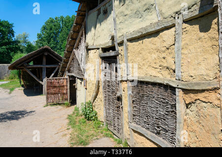 Eindhoven, Netherlands  - June 30, 2018  reconstruction of a wall from clay in the prehistoric village. - Stock Photo