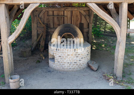 Eindhoven, Netherlands  - June 30, 2018 a stone oven in the prehistoric village - Stock Photo