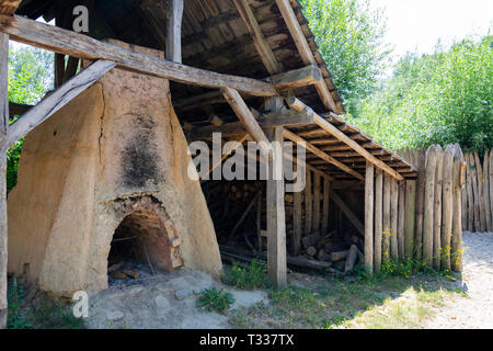 Eindhoven, Netherlands  - June 30, 2018 reconstruction of a clay oven in the prehistoric village - Stock Photo