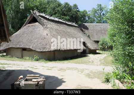 Eindhoven, Netherlands  - June 30, 2018 reconstruction of a large prehistoric House from the iron age in the prehistoric village - Stock Photo