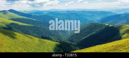 panorama of rolling hills of the ridge in summer. valley down below. grassy alpine slopes. sunny weather - Stock Photo