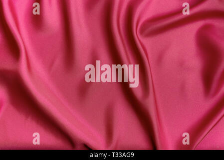 Red silk canvas cloth waves background or texture - Stock Photo