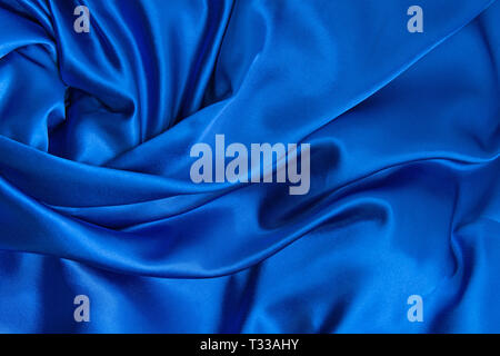 Blue silk canvas cloth waves background or texture - Stock Photo