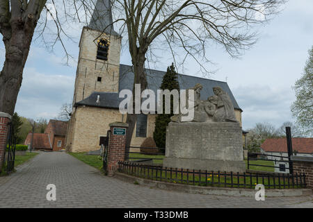 Monument remembering the victims of World War 1 and 2 in front of the church in Leefdaal, Belgium - Stock Photo