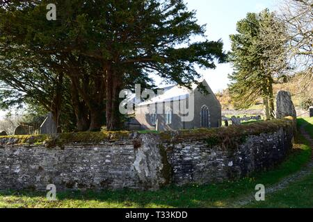 St Johns Church Ysbyty Cynfyn with a circular churchyard with a Bronze Age stone circle built into the surrounding wall  Cardiganshire Wales - Stock Photo