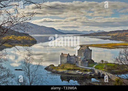 EILEAN DONAN CASTLE DORNIE SCOTLAND VIEW OVER LOCH DUICH TOWARDS THE CUILLIN MOUNTAINS IN SPRING - Stock Photo
